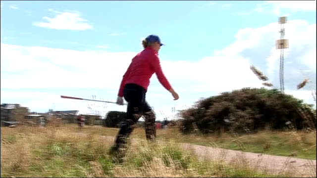 interview with 17-year-old golfer charley hull ahead of women's british open; scotland: fife: st andrews: hull taking shot in rough and along charley... - sportlerin stock-videos und b-roll-filmmaterial