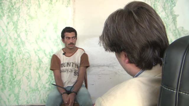 interview with a captured isis fighter. the interview was conducted under strict supervision of the kurdish security forces, the asayish /the man had... - isis beheading stock-videos und b-roll-filmmaterial