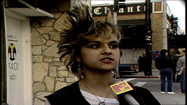 interview with a punk girl about different 80s cars in los angeles, california - mos stock videos & royalty-free footage