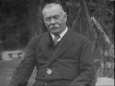interview with author sir arthur conan doyle, here discussing how he came about with the creation of sherlock holmes; interview is conducted outside... - author stock videos & royalty-free footage
