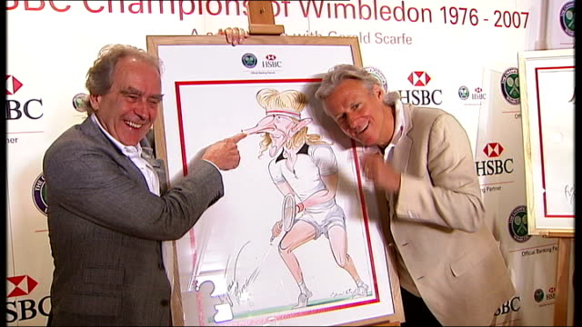 interview with bjorn borg / gerald scarfe exhibition and photocall; borg and scarfe posing for photocall with pictures - gerald scarfe stock videos & royalty-free footage