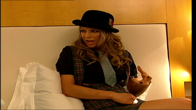 interview with 'black eyed peas' singer fergie england london int 'fergie' interviewed in hotel room by tamzin sylvester sot on being in... - the black eyed peas band stock videos and b-roll footage