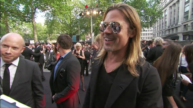 interview with brad pitt who speaks about angelina jolie's double mastectomy and describes her return to the red carpet as 'heroic' and on making the... - brad pitt attore video stock e b–roll