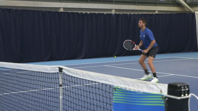 interview with british men's tennis number one cameron norrie; england: london: national tennis centre: int cameron norrie practicing tennis norrie... - itv lunchtime news stock videos & royalty-free footage