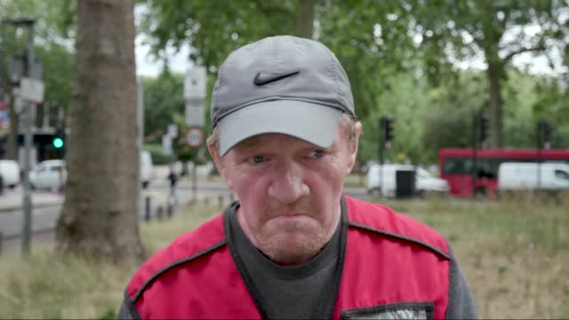 interview with dave martin big issue vendor in hammersmiththe big issue group have kitted out their vendors with ppe and contactless payment... - selling stock videos & royalty-free footage