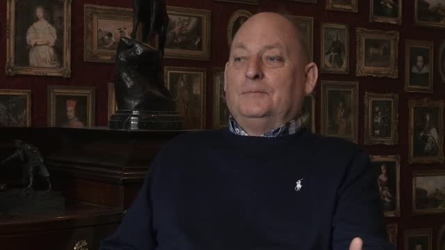 interview with derbyshire businessman garry mcbride, who commissioned a captain sir tom moore bust last year which ended up at st james' hospital in... - ダービーシャー点の映像素材/bロール