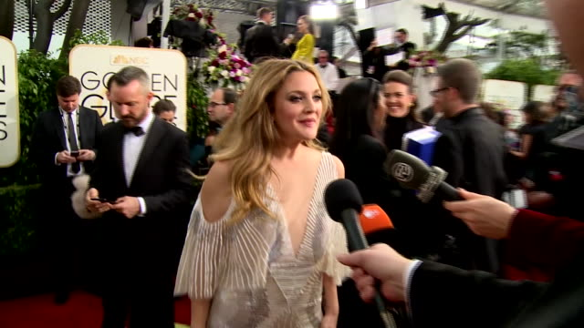 Interview with Drew Barrymore on the red carpet during the 74th Annual Golden Globe Awards