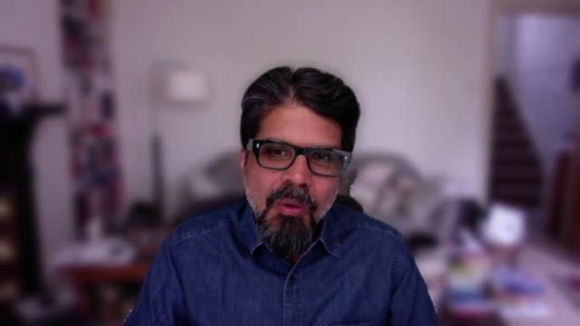 interview with essayist and novelist pankaj mishra; england: london: int reporter asking question pankaj mishra interview via internet sot - krishnan guru murthy stock videos & royalty-free footage