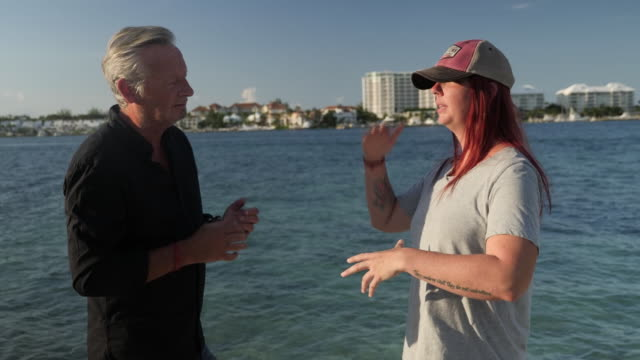 interview with hurricane dorian survivor as aid arrives. shows: interviews with survivor michelle russell, aid personnel checking documents and... - sopravvivenza video stock e b–roll