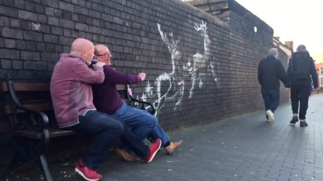 interview with jewellers martin clarke and pete smith graffiti artist banksy has installed a new piece in birmingham showing two reindeer pulling a... - 英国 バーミンガム点の映像素材/bロール