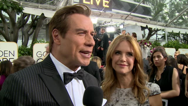 interview with john travolta on the red carpet during the 74th annual golden globe awards - 第74回アカデミー賞点の映像素材/bロール