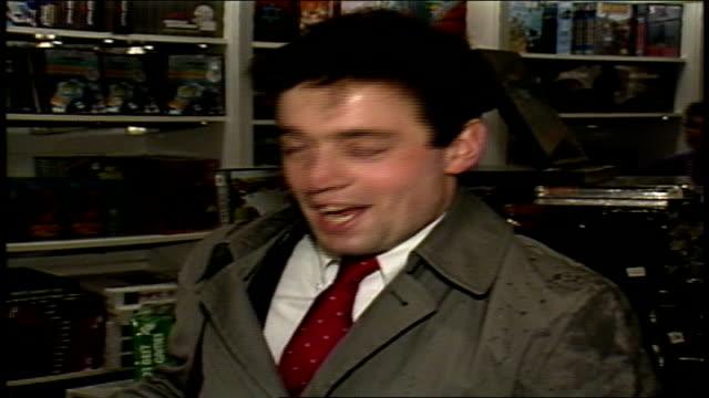 interview with man buying trump board game - 1989年点の映像素材/bロール