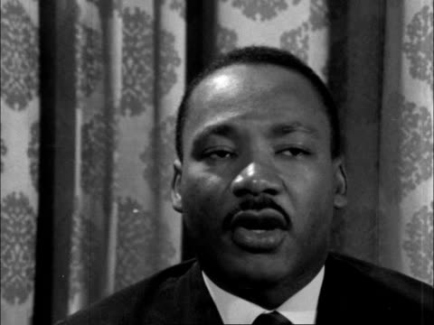 interview with martin luther king jr; england: london: chapter house:intms and martin luther king interview sof: i don't think that's true, and i... - アメリカ黒人の歴史点の映像素材/bロール