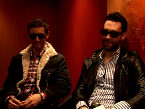 interview with members of maroon 5; adam levine and jesse carmichael interview sot - on not playing uk summer music festivals and playing festivals... - ポピュラーミュージックツアー点の映像素材/bロール