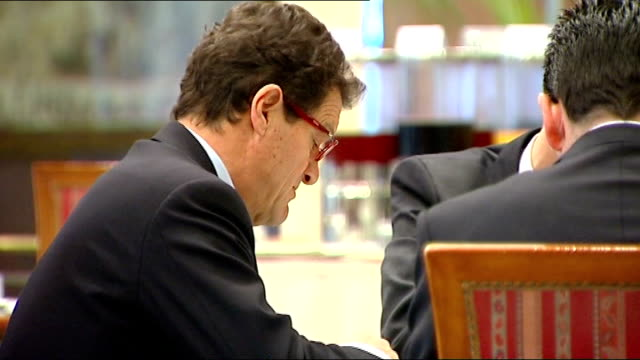 interview with new england manager fabio capello; capello sat talking with others / capello along through hotel / capello sat with sir trevor... - national team stock videos & royalty-free footage