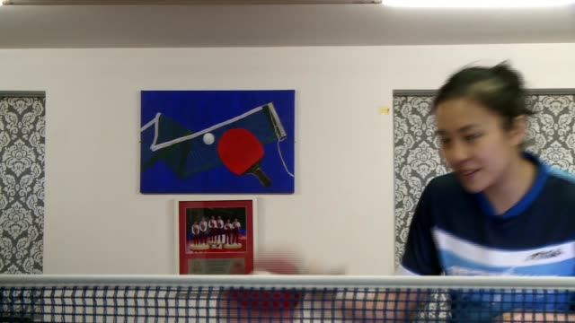 interview with olympic hopeful tintin ho england london int tintin ho interview sot in painting of table tennis paddle net and ball on wall behind... - netting stock videos & royalty-free footage