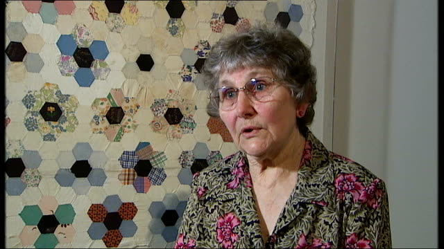 interview with one of the creators of the changi quilts close up information label on quilt showing history of where and how it was made olga... - decapitated stock videos & royalty-free footage