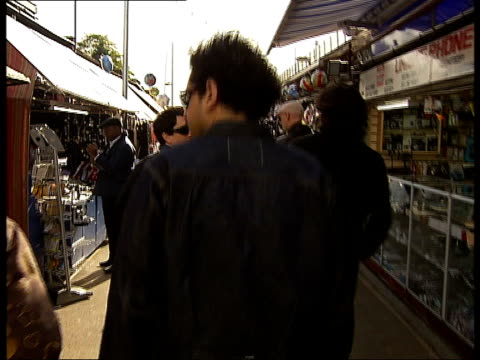 london shepherds bush ext interview with members of orson as walking along in shepherd bush market - jason george stock videos and b-roll footage