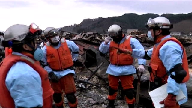 Interview with Patrick Fuller IFRC spokesperson / Rescue teams in Otsuchi / General Views of the massive destruction caused by the tsunami in the...