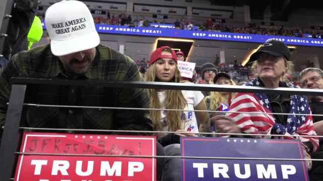 interview with qanon conspiracy theorist about 'jfk jr is alive' sign at president trump rally at target center, minneapolis, minnesota. crowd.... - conspiracy stock videos & royalty-free footage