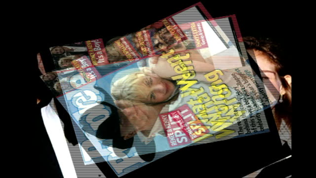 interview with singer keith urban; front cover of people magazine showing renee zellweger next kenny chesney - in front of点の映像素材/bロール