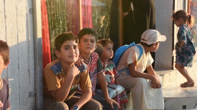 interview with syrian omar abu nahla, a resident of kafr lusin refugee camp, on the first day of the muslim festival of eid al-adha at a market near... - holiday camp stock videos & royalty-free footage