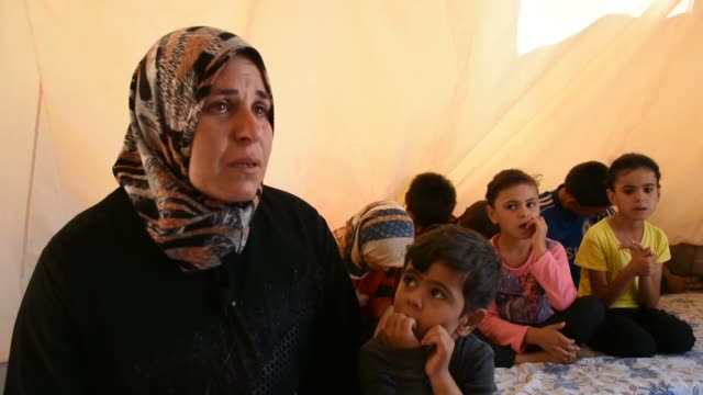 interview with syrian um mahmoud, a turkmen mother who lost her husband earlier to a regime airstrike, on the first day of the muslim festival of eid... - holiday camp stock videos & royalty-free footage
