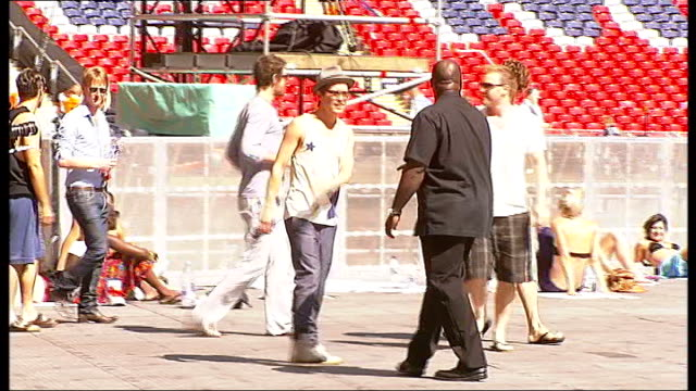 Interview with 'Take That' ENGLAND London Wembley Stadium INT Various of stage crew at work setting up arena for Take That final gig at end of Circus...