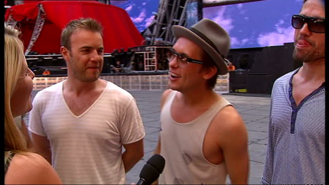 interview with 'take that'; gary barlow, mark owen, howard donald, jason orange interview sot - on the support of their fans during the tour / on the... - ポピュラーミュージックツアー点の映像素材/bロール