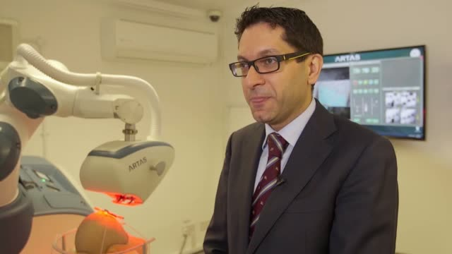 stockvideo's en b-roll-footage met interview with transplant surgeon mr ali soueid plastic surgeon at skin follicle clinic in birmingham he explains what the robot can do how it's... - plastische chirurg
