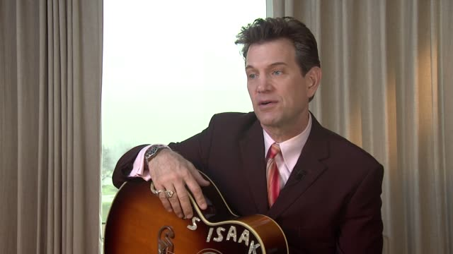 vídeos de stock, filmes e b-roll de chris isaak on how music as an art and escapism on a tapestry he saw that moved him at chris isaak interview the royal garden hotel on 24th january... - chris isaak