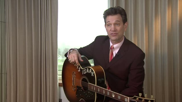 vídeos de stock, filmes e b-roll de chris isaak on the his attitude to the duration of concerts and songs at chris isaak interview the royal garden hotel on 24th january 2012 in london - chris isaak