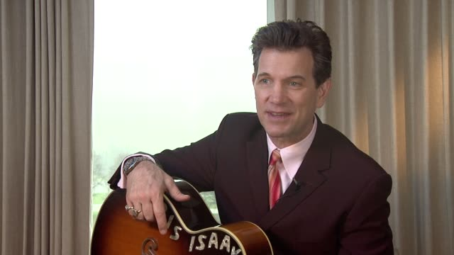 vídeos de stock, filmes e b-roll de chris isaak on working with legends at chris isaak interview the royal garden hotel on 24th january 2012 in london - chris isaak