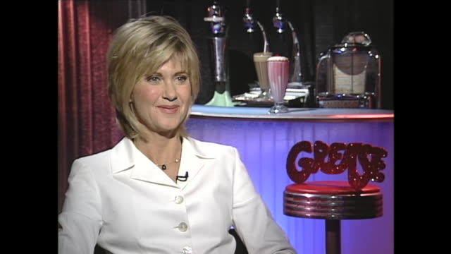 """olivia congratulations on the re release of """"grease"""" it's great to see it back in the theaters after 20 years now i understand you were a little... - olivia newton john stock videos & royalty-free footage"""