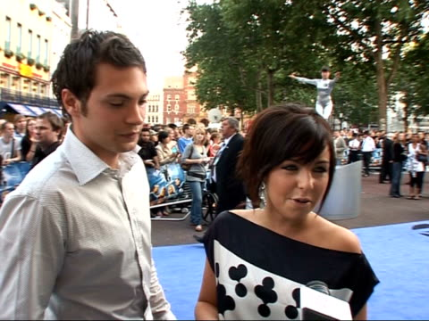 interviews and photocalls on red carpet at 'fantastic four: rise of the silver surfer' film premiere; louise lytton and matt di angelo interview sot... - 作品名 ファンタスティック・フォー点の映像素材/bロール