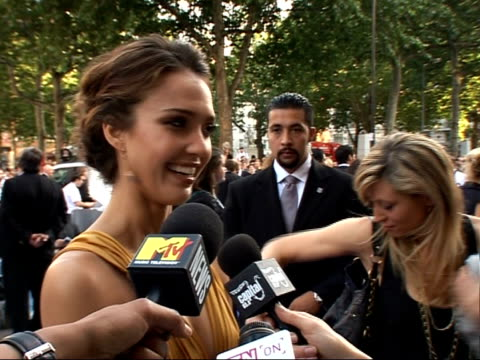 interviews and photocalls on red carpet at 'fantastic four rise of the silver surfer' film premiere back view of alba signing autographs / jessica... - spandex stock videos & royalty-free footage