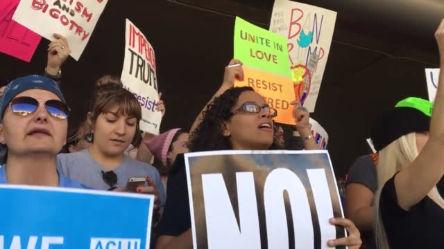 vídeos de stock, filmes e b-roll de interviews sot b roll protesters are rallying against president trump's executive order barring us entry to refugees and greencard holders from seven... - b roll