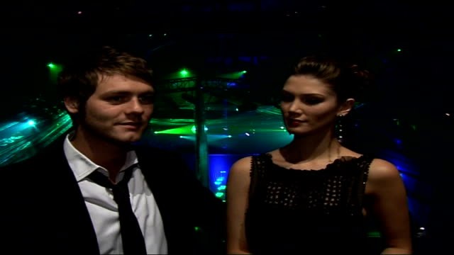 interviews with celebrities attending emeralds & ivy ball; brian mcfadden and delta goodrem interview sot - would do anything to help a good friend... - brian wells stock videos & royalty-free footage