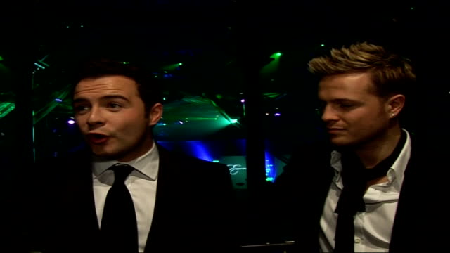interviews with celebrities attending emeralds ivy ball england london the roundhouse shane filan and nicky byrne interview sot on cancer research uk... - attending stock videos and b-roll footage