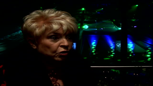 interviews with celebrities attending emeralds & ivy ball; gloria hunniford interview sot - on her work for cancer research uk / link between marie... - グロリア ハニフォード点の映像素材/bロール