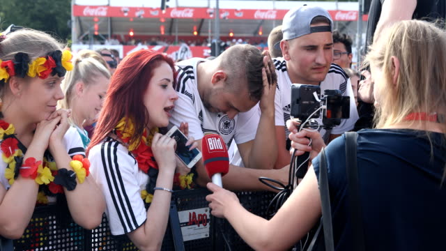 Interviews with disappointed fans on the fan mile at the Brandenburg Gate after the historic defeat of the German national football team 2018 FIFA...