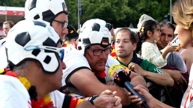 interviews with disappointed fans on the fan mile at the brandenburg gate after the historic defeat of the german national football team 2018 fifa... - national team stock videos & royalty-free footage
