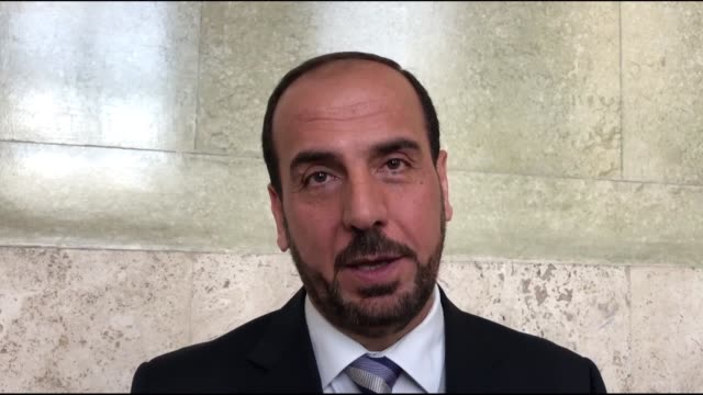interviews with naser al-hariri, geneva negotiations head of the high negotiations committee, and hadi al-bahra, former president of the syrian... - former stock videos & royalty-free footage