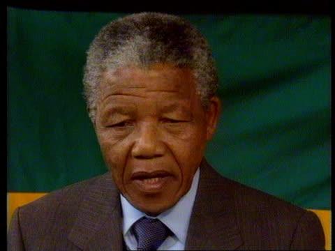 Interviews with Nelson Mandela FW De Klerk ITN Soweto EXT CMS Trevor McDonald handshakes with Nelson Mandela CMS McDonald leads Mandela over to seat...