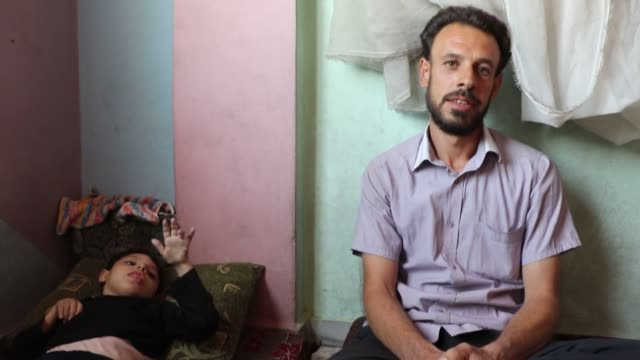 Interviews with Syrian Abu Suleiman who has two disableddaughters and pediatrician Abu Jamil in the Eastern Ghouta region of Damascus Syria on...