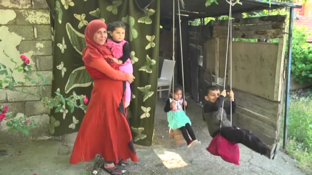 interviews with syrian mona almasri and syrian hi in ankara turkey despite ongoing conflict and challenges in their home country two syrian mothers... - family with four children stock videos & royalty-free footage