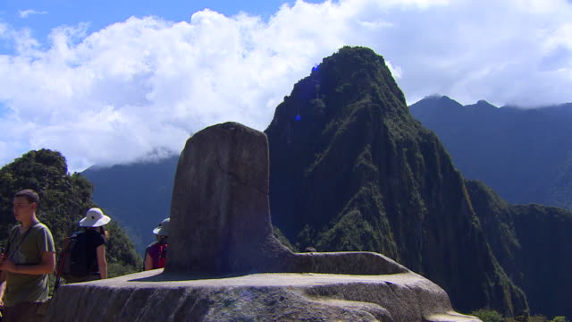 intihuatana stone in machu picchu, peru - stone object stock videos and b-roll footage