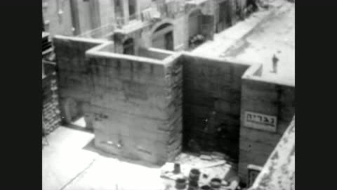 intimidating brick wall dividing jerusalem / bombed out buildings visible in the distance / the wall begins to crumble and fall / bulldozer clearing... - 1967 stock videos & royalty-free footage