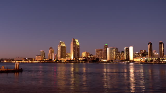 ws t/l zi into san diego skyline from dusk to night as seen across the bay from coronado island  / san diego, california, usa - dusk to night stock videos and b-roll footage