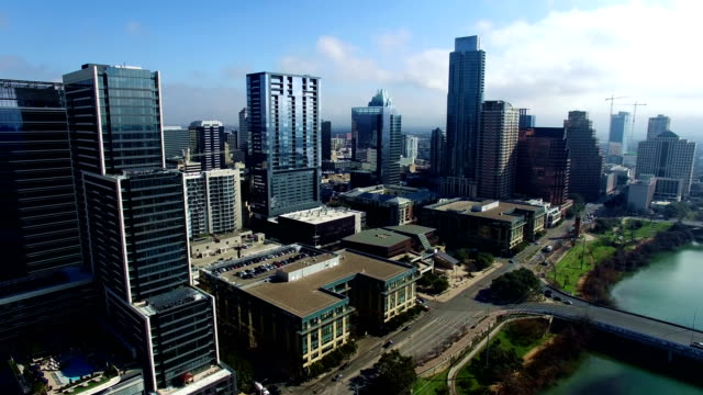 into the light moving towards downtown austin texas skyline compact highrises and massive condominiums - austin texas stock videos & royalty-free footage